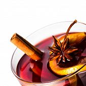 Hot Red Mulled Wine For Christmas  And Winter With Orange Slice, Anise And Cinnamon Sticks Isolated