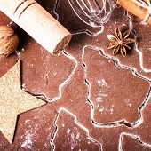 Christmas And Holiday Gingerbread Baking Background Dough, Flour, Bakeware, Cinnamon, Cookie Cutters