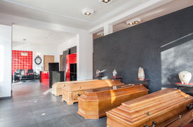 picture of urn funeral  - Coffins and urns in a funeral office - JPG