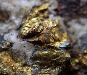 stock photo of iron pyrite  - Crystalnugget gold bronze copper iron. Macro. Extreme closeup