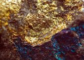 stock photo of iron pyrite  - Nugget gold bronze copper iron. Macro. Extreme closeup