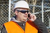 Engineer with the cell phone