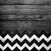 stock photo of chevron  - Colorful chevron pattern on wood texture background - JPG