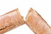 Broken long brown loaf.