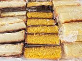 Slices of cakes of maize and cassava - packed in cling film
