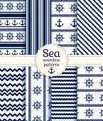 stock photo of navy anchor  - Set of sea and nautical seamless patterns in white and navy blue colors - JPG