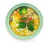 Thai cuisine green curry vegetables on white background