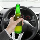 Male Holding Bottle Of Beer While Driving Car - 1 To 1 Ratio