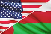 Series Of Ruffled Flags. Usa And Sultanate Of Oman.