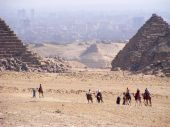 Camel trail in front of pyramids at Giza
