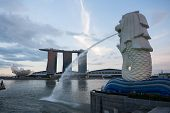 SINGAPORE - NOVEMBER 07, 2012: Fountain-statue of the Merlion and hotel Marina Bay Sands in Singapor