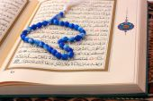 The Holy Koran Page With Blue Rosary