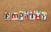 foto of empathy  - The word Empathy in cut out magazine letters pinned to a cork notice board - JPG