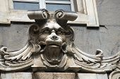 stock photo of genova  - Ancient grotesque stone mask on the facade of the building Tursi  - JPG