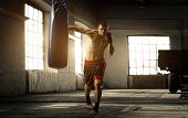 foto of attic  - Young man boxing workout in an old building - JPG