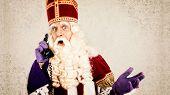 Sinterklaas with old vintage telephone.  Dutch character of Santa Claus