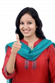 Happy Young Woman Making Thumbs Up Gesture