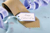 Happy Fathers Day Yellow Tie With Gift Tag On Vintage Aqua Blue Rustic Shabby Chic Table