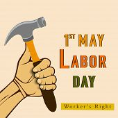 Vintage poster, banner or flyer design with human hand holding a hammer and stylish text 1st May Labor Day on abstract background.