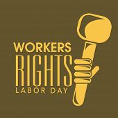 World Labor Day concept with stylish text Workers Rights and illustration of a human hand holding hammer on brown background.