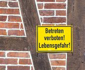 german sign - danger to life, do not enter - at a house wallsgefahr At A  Wall