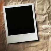 polaroid style photo frames on cardboard