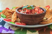 Nachos with homemade salsa and pepper