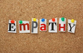 image of empathy  - The word Empathy in cut out magazine letters pinned to a cork notice board - JPG