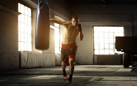 stock photo of boxing  - Young man boxing workout in an old building - JPG