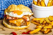 Homemade Burger With Fried Egg And Spicy Fries
