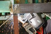 Worker Welding Steel Construction By Electric Welding