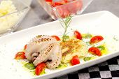 Ocotpus With Mashed Potatoes Inside A Plate With Delicious Composition With Cherry Tomatoes And Pest