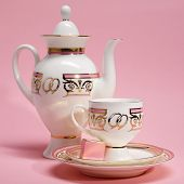 Tea Set With Candy On Pink Background