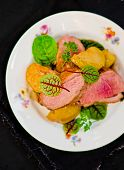 stock photo of duck breast  - duck breast with pears and a green salad - JPG