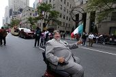 Parade goer in motorized chair
