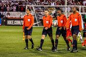 HARTFORD - OCTOBER 10: Referees on Rentschler Field stadium before soccer match between US Men`s National Team vs Ecuador, on October 10, 2014, in Rentschler Field stadium, Hartford, USA.