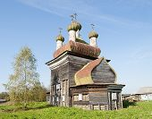 Ancient Wooden Church In Arkhangelo Village, North Russia