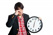 Asian Man Sleepy In The Morning Hold A Clock