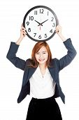 Asian Businesswoman Hold A Clock Over Head