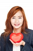 Happy Asian Businesswoman Show Red Heart On Her Palm Hand