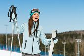 Half-length portrait of female downhill skier. Concept of winter sports and cute entertainment