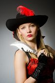 pic of buccaneer  - Woman pirate with sharp knife - JPG