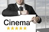 Businessman Pointing On Sign Cinema