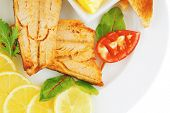 roast salmon and butter with tomatoes and lemon