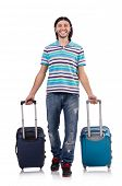 Young man traveling with suitcases isolated on white
