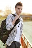 Outdoor Lifestyle Portrait Of Handsome Guy With Backpack