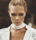 Portrait Of A Futuristic Model Of A Girl With Smoky Eyes And A Deep Look Outdoors