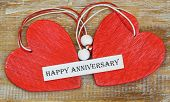 Happy Anniversary card with two red wooden hearts