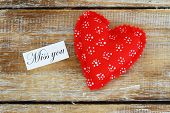 stock photo of miss you  - Miss you card with red heart on rustic wooden surface - JPG