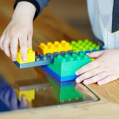 Hand Child Playing With Construction Blocks